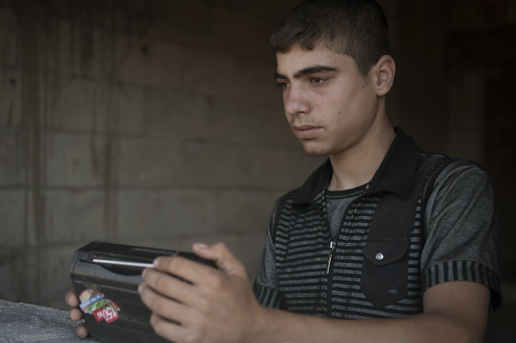 Without anything to do, Sleiman often listens to radio, broadcasting news about the situation in Syria.