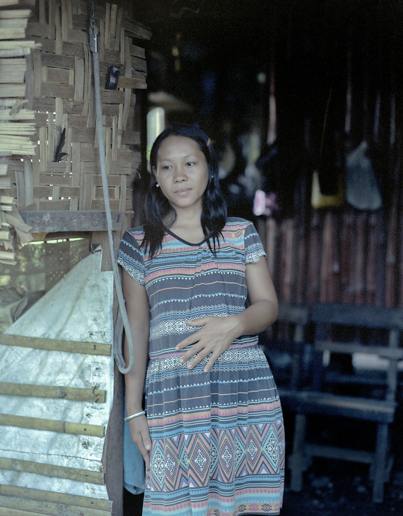 Ronalin in the new hut. She's pregnant with their first baby after the loss of the other three children.