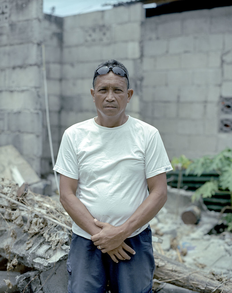 Arturo Rubio 52. Fisherman Standing in what used to be his house. He got his boat destroyed, and are now out of job.