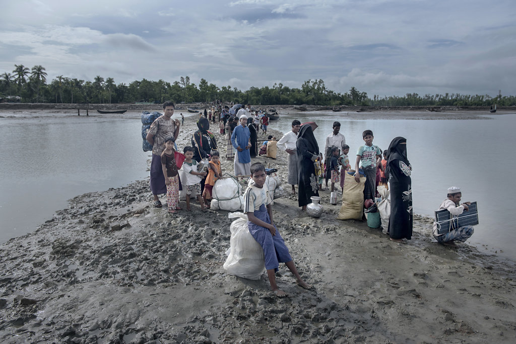 The riverbank of Shahpuree Island. People waiting for boats. Next stop on their journey is Teknaf for registration by the Bangladesh military.