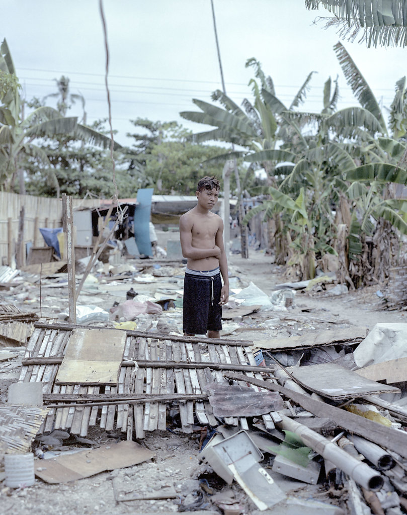 Raymond, 16 years old, standing in, what before the typhoon, was his bedroom. Malapascua island